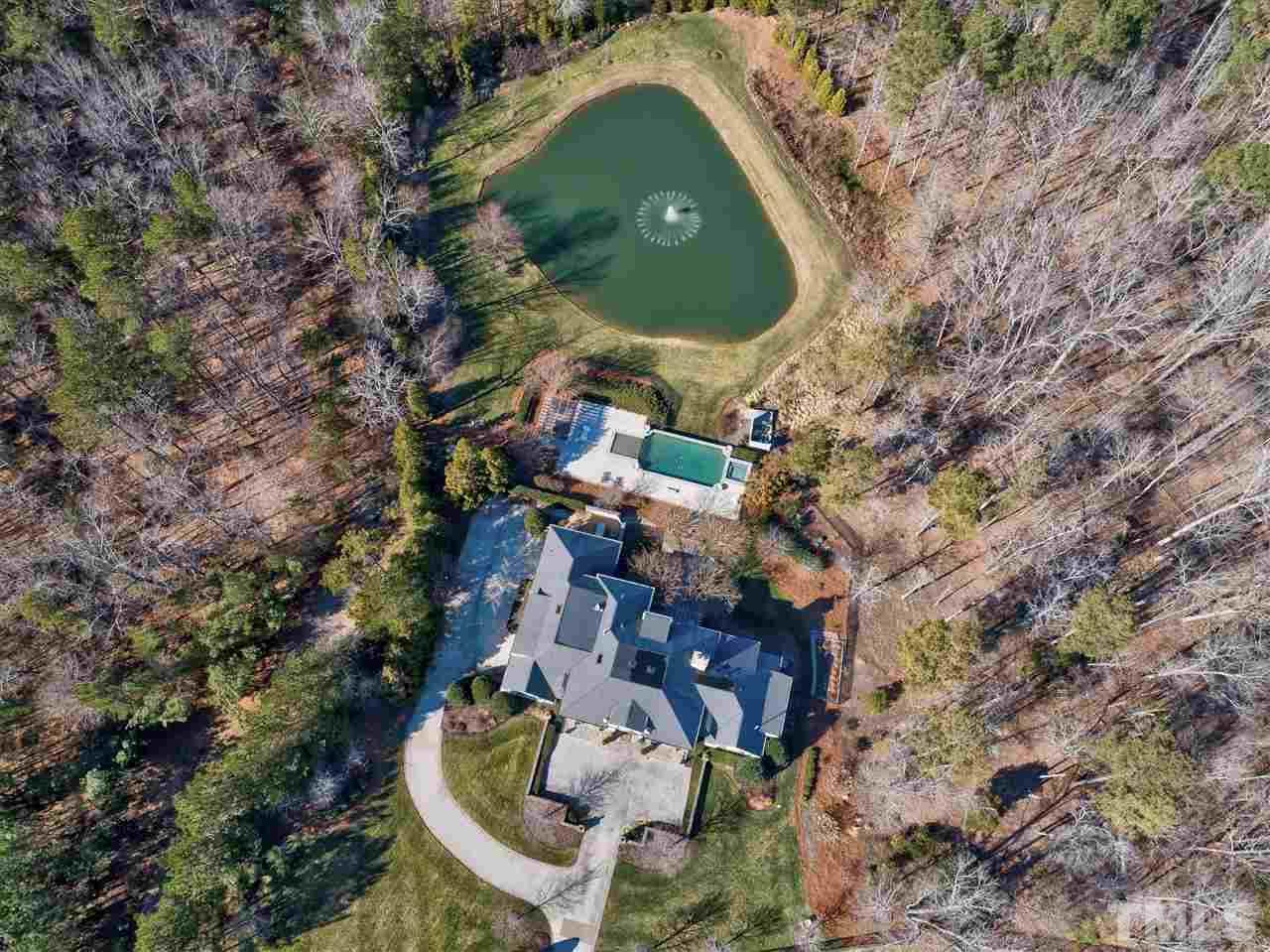 A stunning view of your magnificent chateau. This home has solid concrete walls, ceilings and floors which provides a superior quality of construction. Enjoy lower energy costs and insurance costs and virtually soundproof living floor to ceiling.