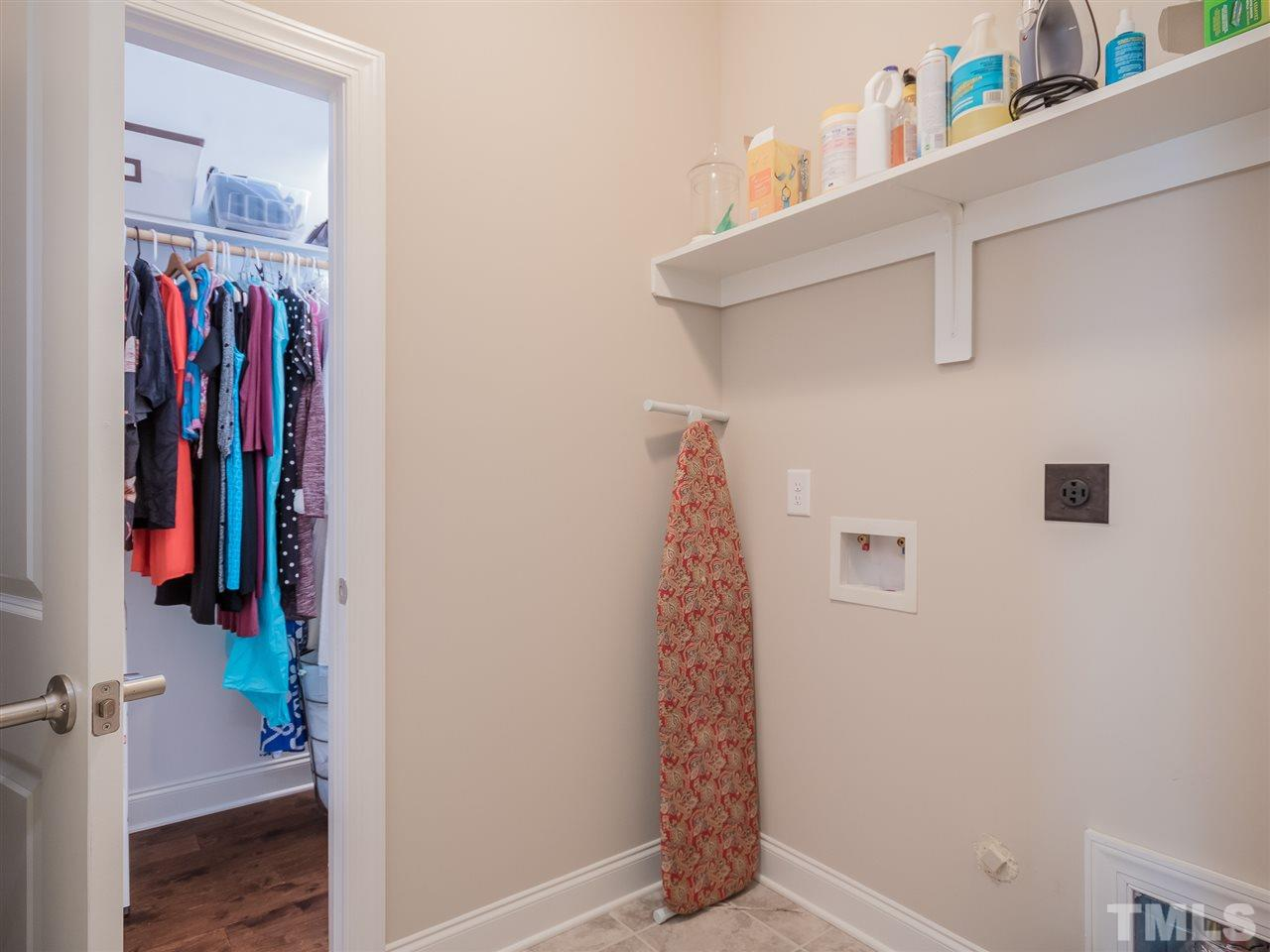 Access to the laundry room from the Owner's closet and the hall. Notice the wood floors in the generous walk-in closet.