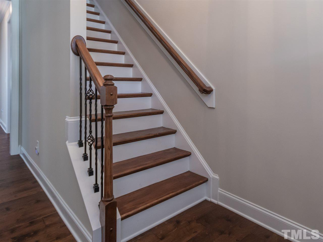 A very nice upgrade, wood stairs with iron pickets    leads to the 4th bedroom, bonus or media room.