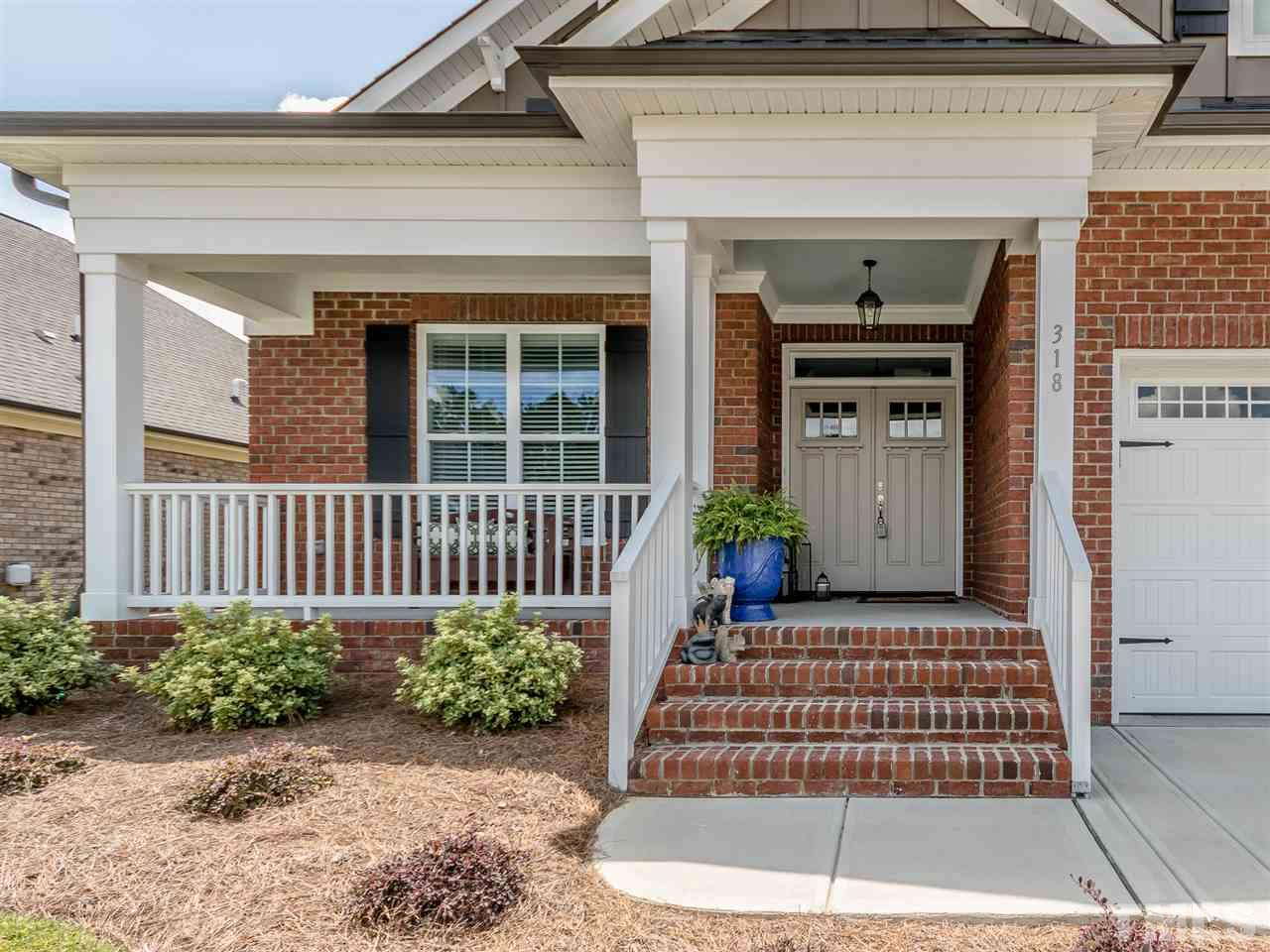 Generous concrete front porch Double doors lead to a delightful home complete with many custom features.