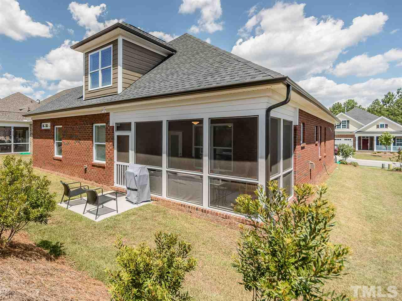 Just enough yard, planting offer privacy and patio for the grill. The home is well thought out and executed. These homeowners have loved their time here.