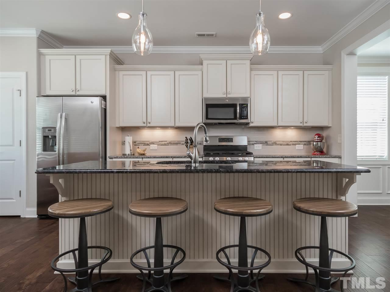 Beautiful granite. Large granite island with high quality cabinets.