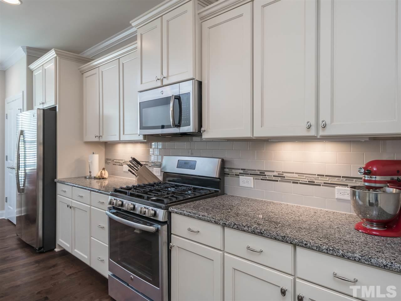 Stainless steel appliances, under counter lighting and pantry.