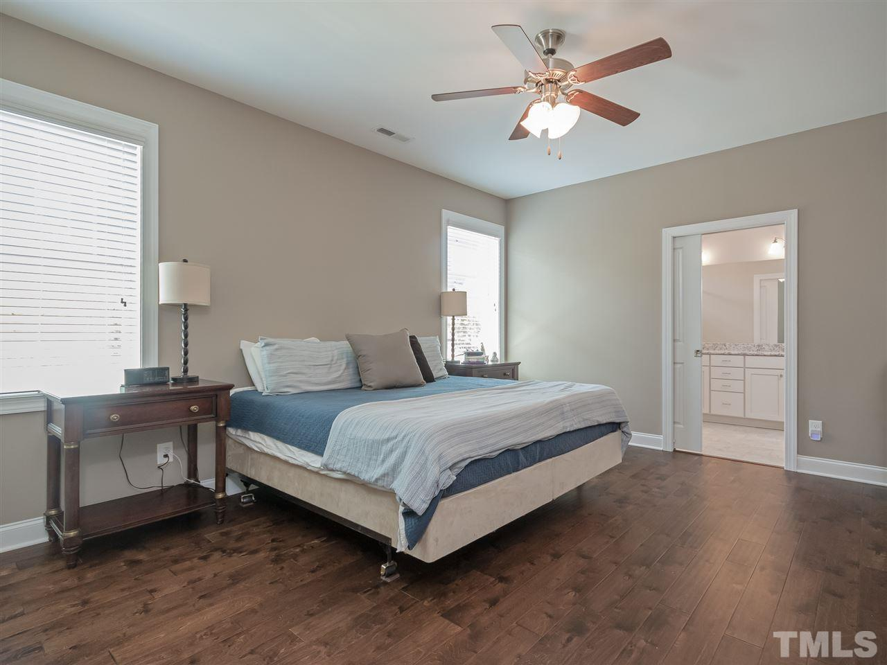 Large owner's suite with upgraded hardwoods floors instead of the standard carpet. Easy access with a wide pocket door for easy access to the owner's bath.