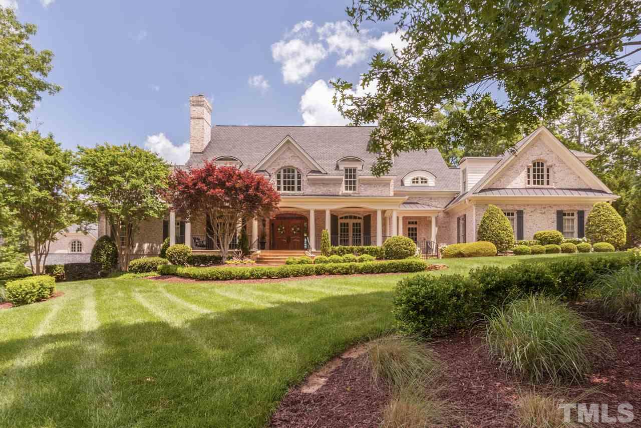 Luxury home builder's former personal home with exquisite attention to craftsmanship and fine architectural details. Home sits  majestically on its 1.47 acre lot that has been extensively  landscaped for year-round enjoyment and beauty.