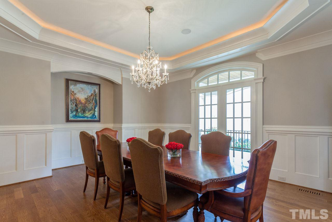 On the main level there is a Butler's Pantry off the Dining Room and a  Beverage Serving Bar off the Family Room. Both areas feature glass cabinets and granite counter tops. There is a wine fridge in the Serving Bar.