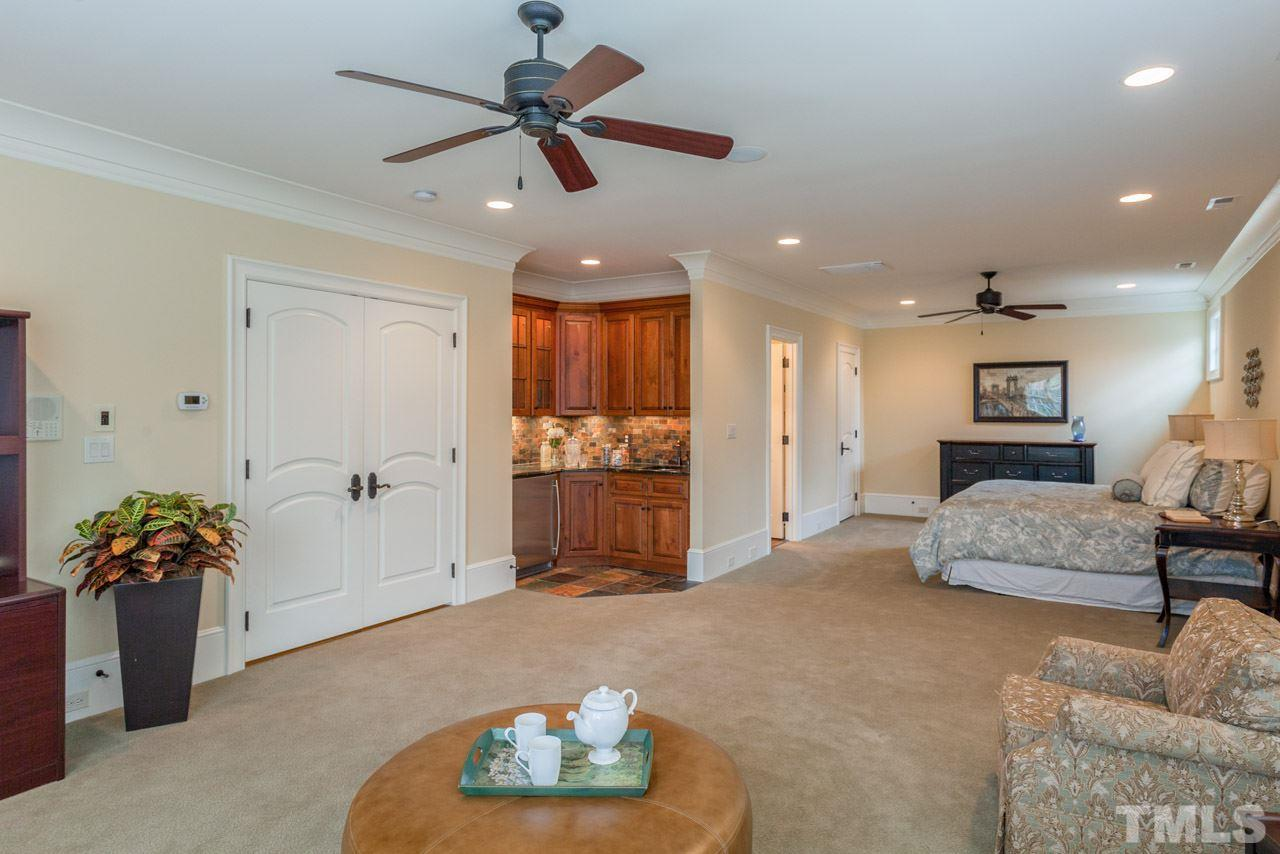Offerings of this spacious bedroom include crown molding, ceiling fan, large walk-in closet, tub/shower combination with tile surround and a bath vanity with granite counters. It also features a designated HVAC thermostat for energy efficiency and comfort