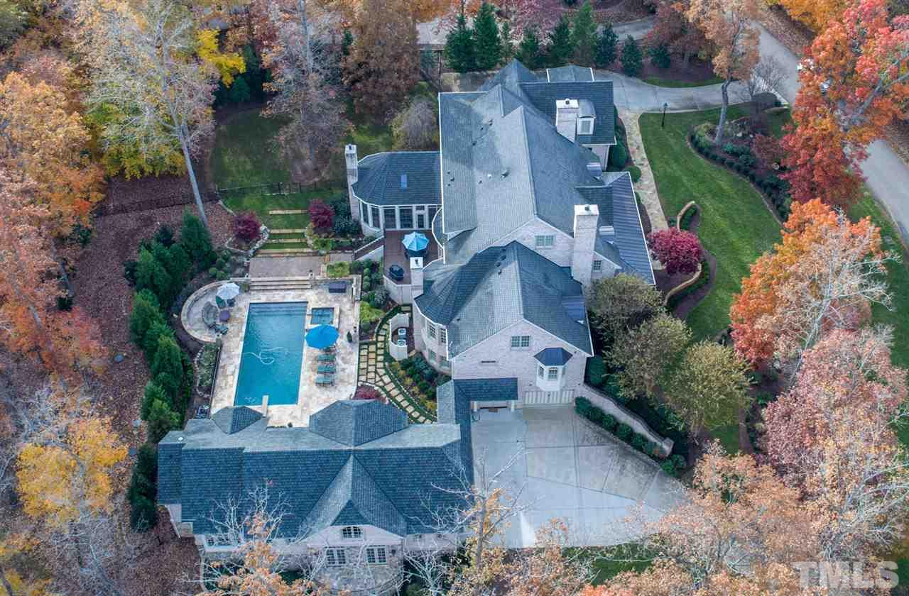 The aerial view shows how the estate is situated on its magnificent lot. There is a main house with a 3 car garage off the east wing, 1 car garage off the west wing, and a detached luxury garage suite with wine room. There are 2 separate driveways.