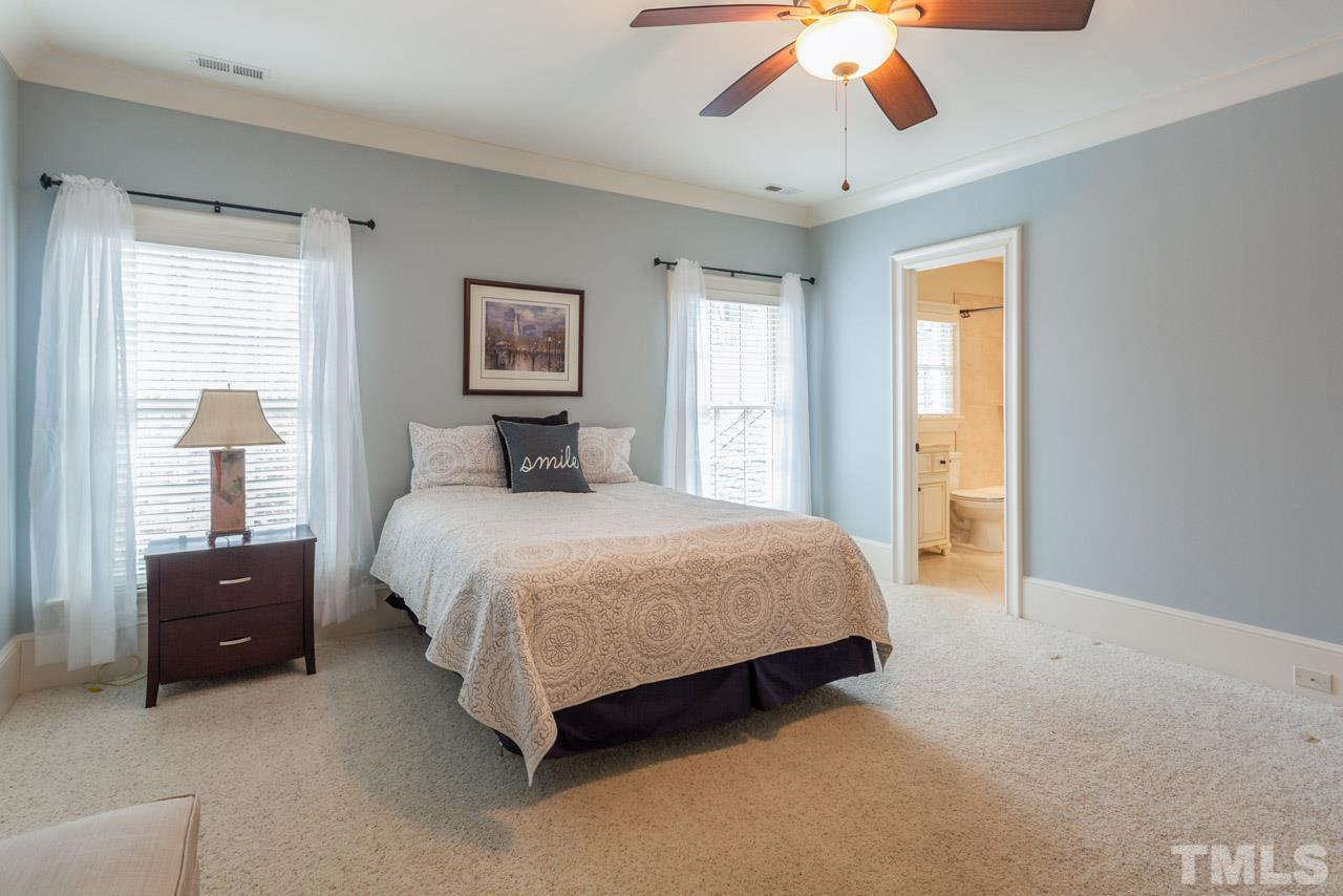 Imagine a Bonus Room that is so spacious that it can comfortably accommodate a pool table and a ping pong table! Additional features include a half bath, 2 ceiling fans, and built-in shelving.