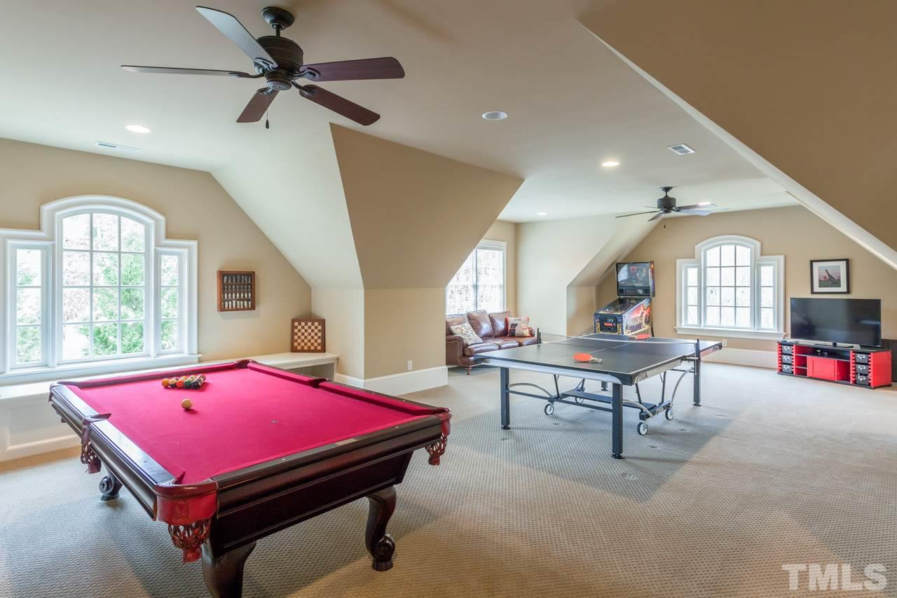 Such versatile space! Features include gas fireplace w/stone surround, wall of built-in shelves, & easy to maintain tile floors which are perfect when coming into the basement from the swimming pool! Double doors lead to 2nd driveway & luxury garage suite