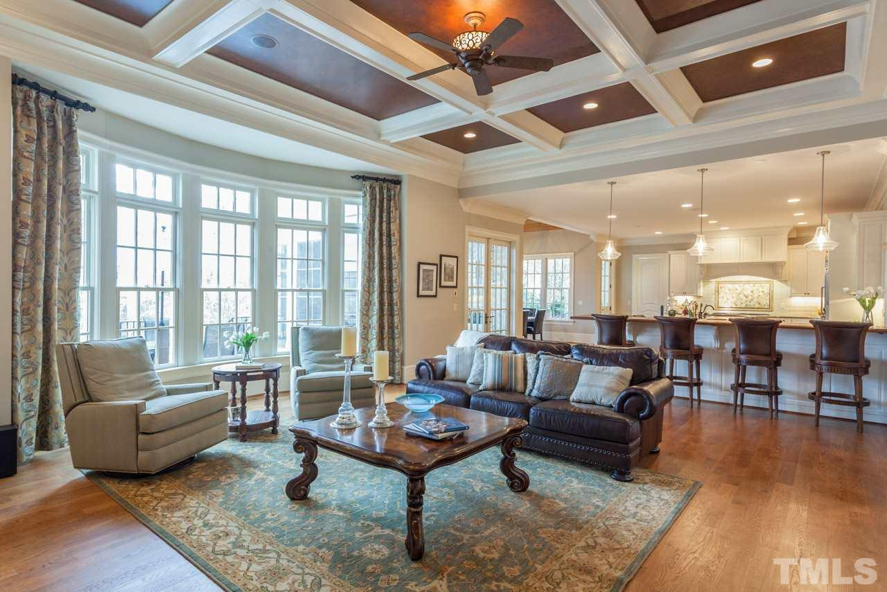 The gracious family room is open to the kitchen and is perfect for gathering with friends and family. It easily accommodates ample furnishes due to its size.  French doors lead from the family room to the amazing screen porch.