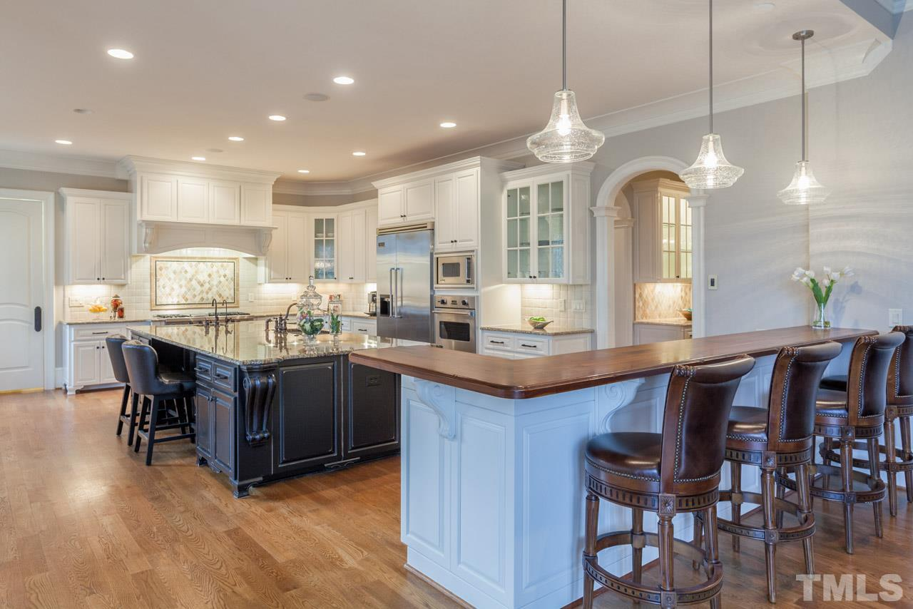 The kitchen is a cook's delight as it offers high-end Viking appliances that include a built-in refrigerator, wall oven, microwave , 2 dishwashers in the island, warming drawer, and a chef's gas range with 6 burners, griddle, and double ovens.