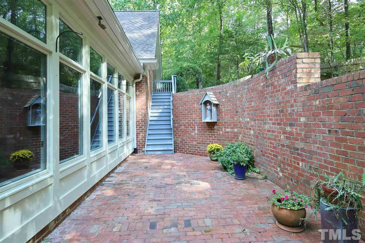 Courtyard off the sunroom, with stairs to nearly finished room over garage...