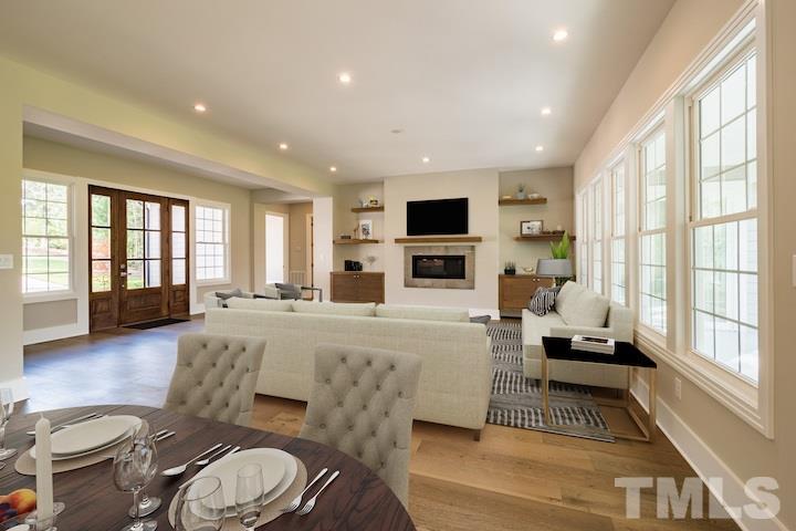 "Engineered Hardwood Flooring & Recessed Lighting Throughout. 42"" Fireplace."