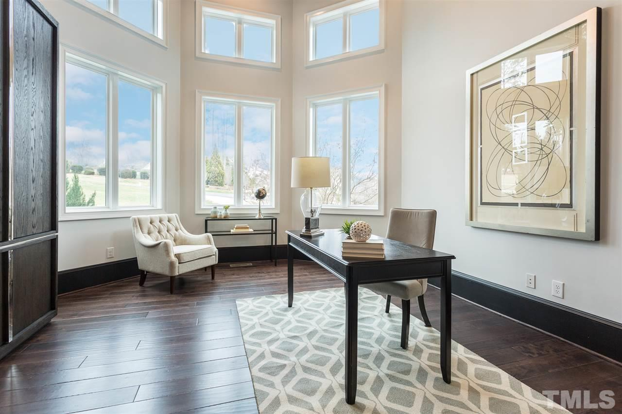 The first floor office features a coffered ceiling, hardwood floors, crystal and chrome chandelier, crown molding and glass French doors.  It is situated in a very quiet and private location on the main level.