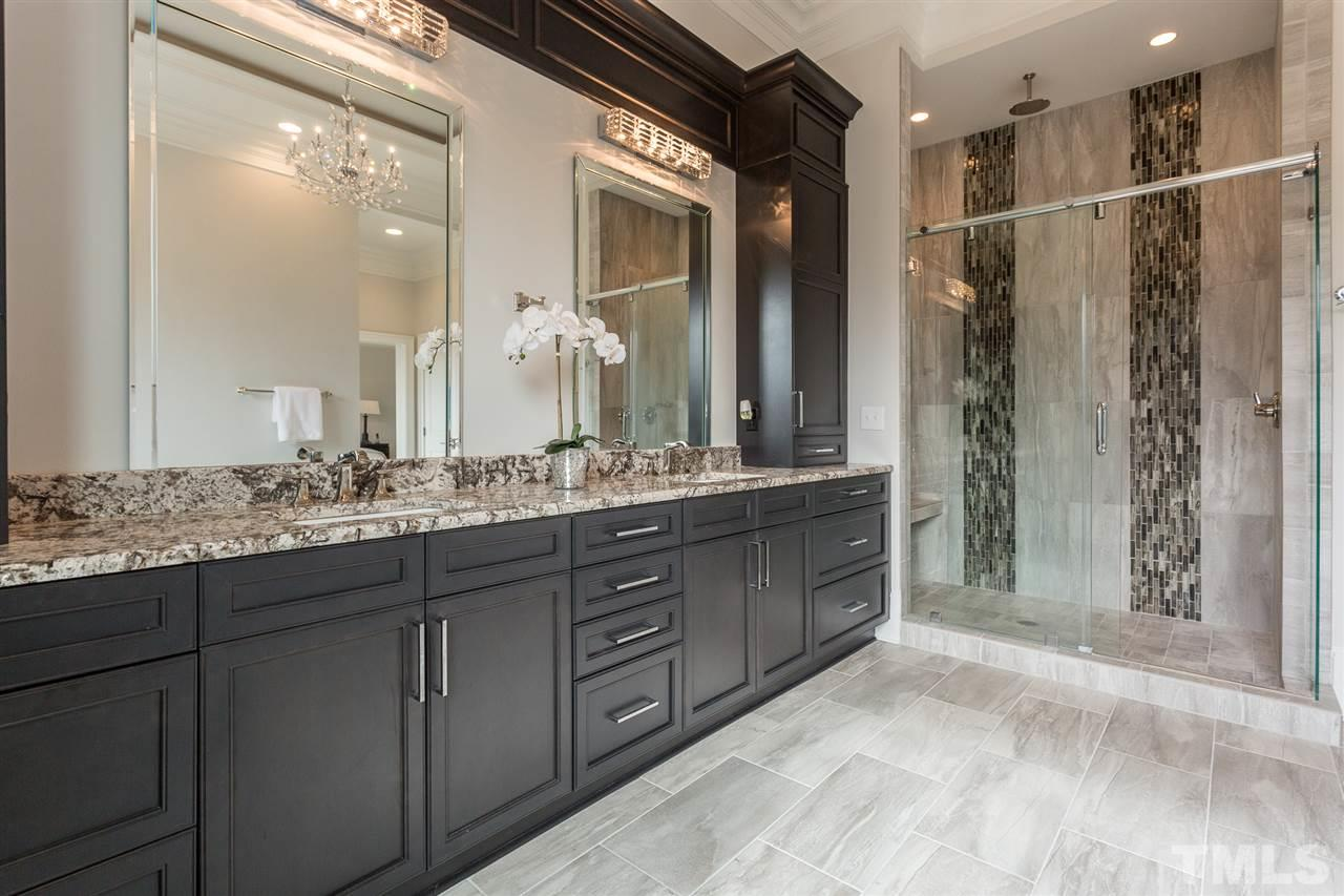 This delightful bedroom showcases two hanging chandeliers, double closets and a private full bath with a tub/shower combination.