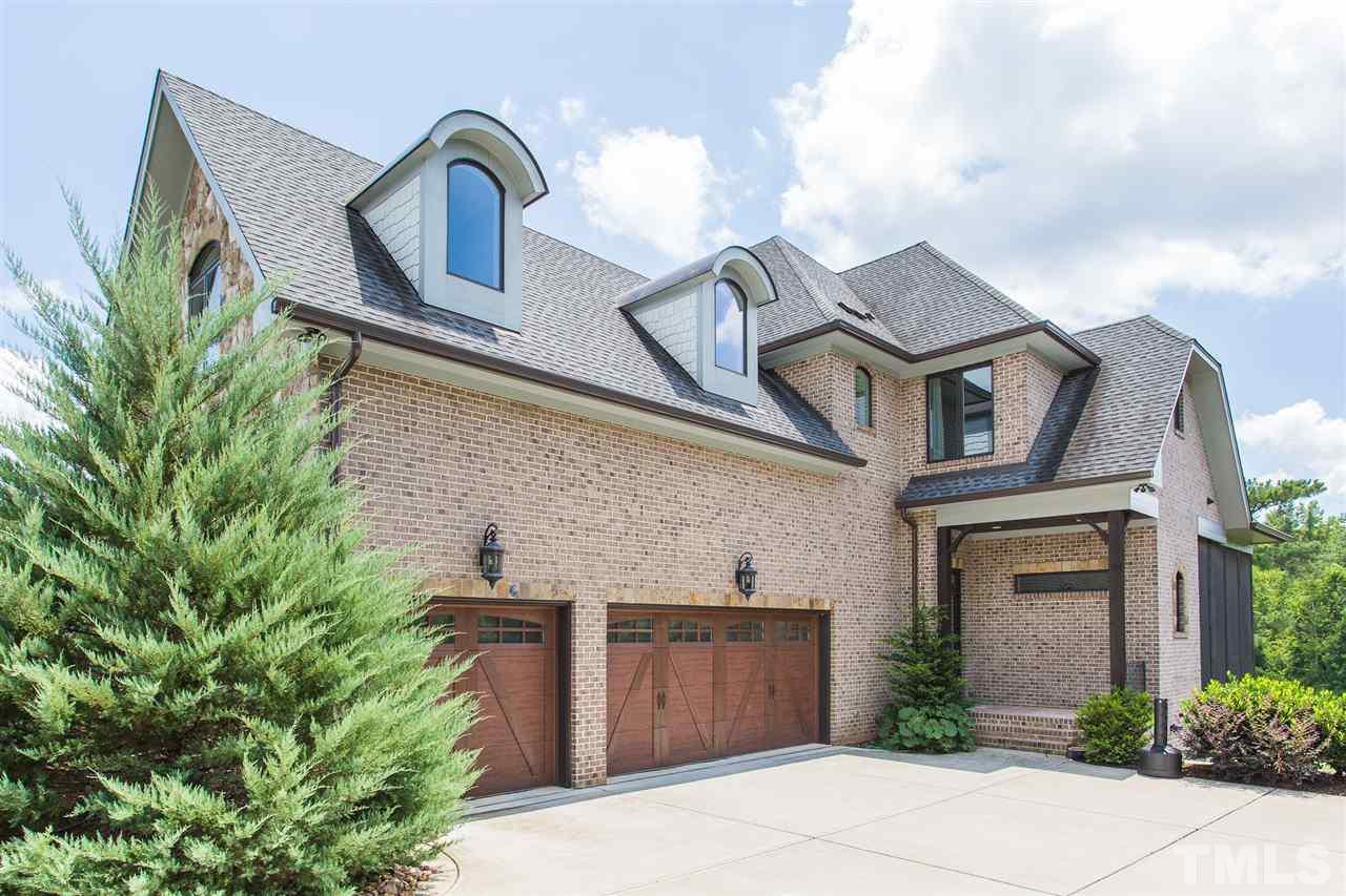 The home has a 3 car side load garage on the main level AND a 2 car side load garage on the basement level.