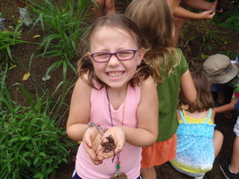 Girl holding worms