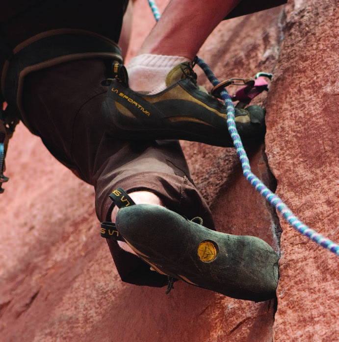 Here one can see shoe gear that is specific for climbing in cracks within the rock wall. This type of climbing shoe typically has a stiff toe box to accommodate the terrain.