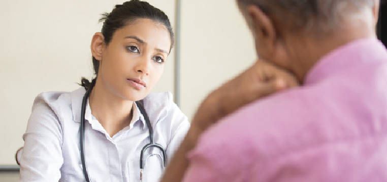 Doctor having concern with patient