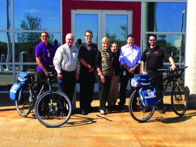 Recognize employee contributions: Members of the MedStar Mobile Healthcare bike team pose with  Forth Worth Mayor Betsy Price.