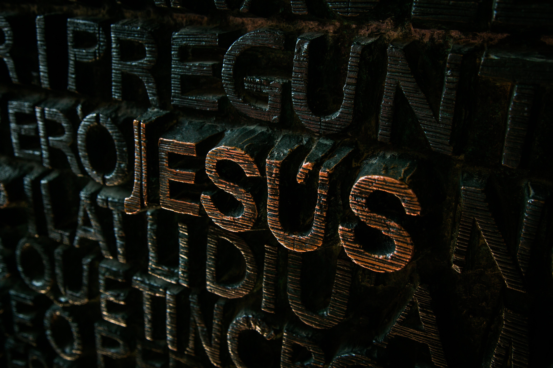 Jesus written on rock