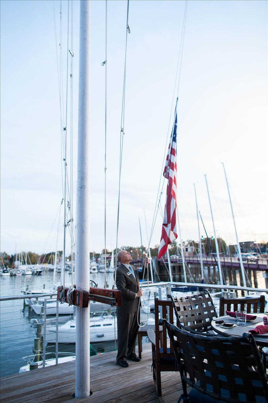 Lowering the flag at sunset at the Annapolis Yacht Club