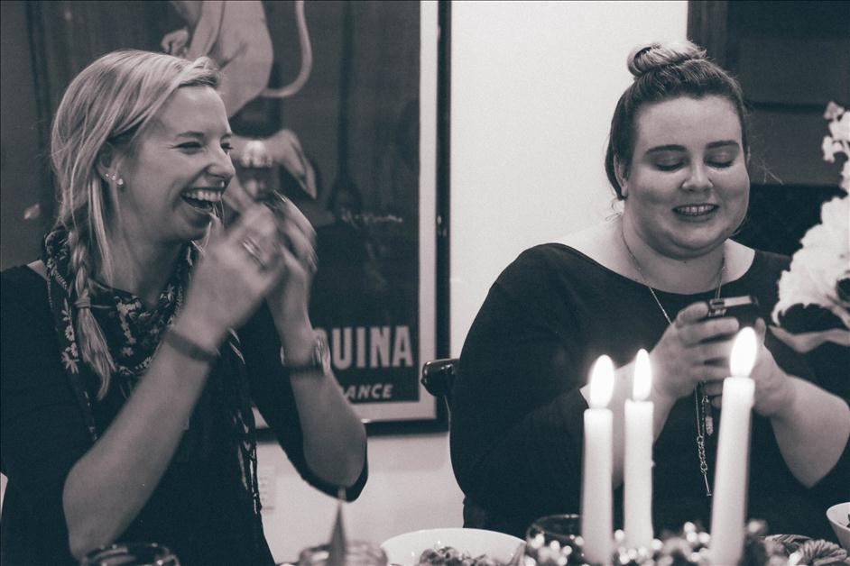 Girls laughing at Friendsgiving celebration
