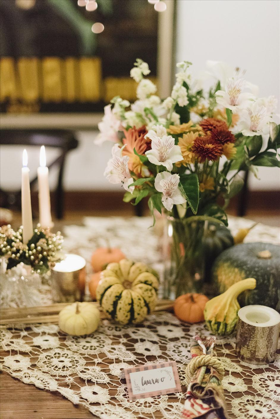 Flowers and pumpkin decor for Thanksgiving table