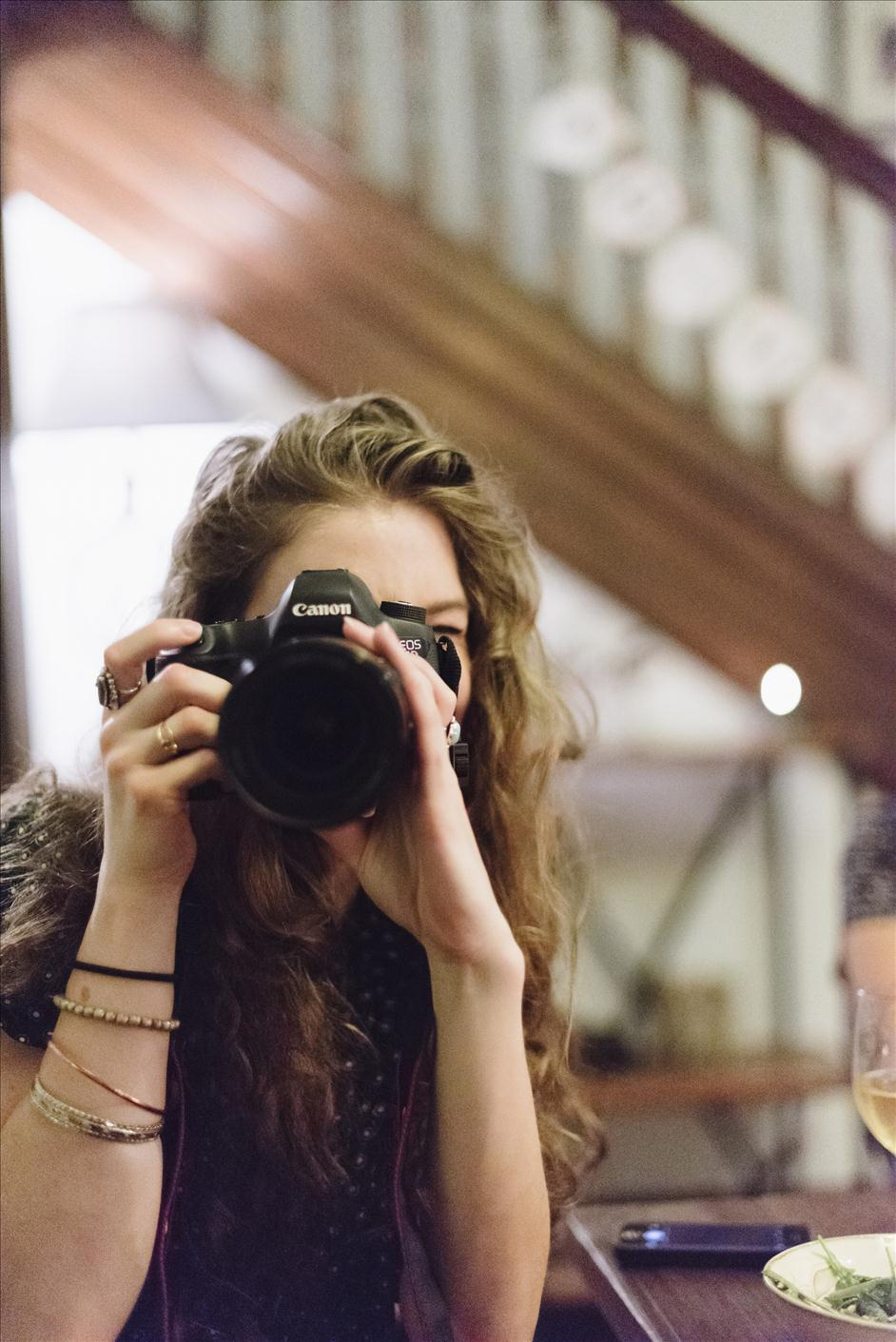 Photographer holding camera at Friendsgiving