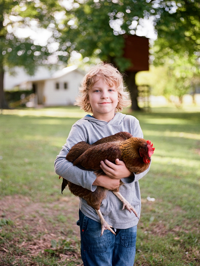 Warthan Farms photo of young boy holding chicken