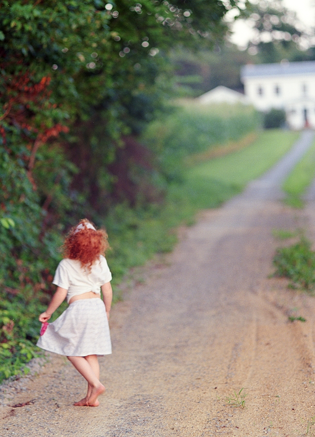 Red headed girl on a dirt road