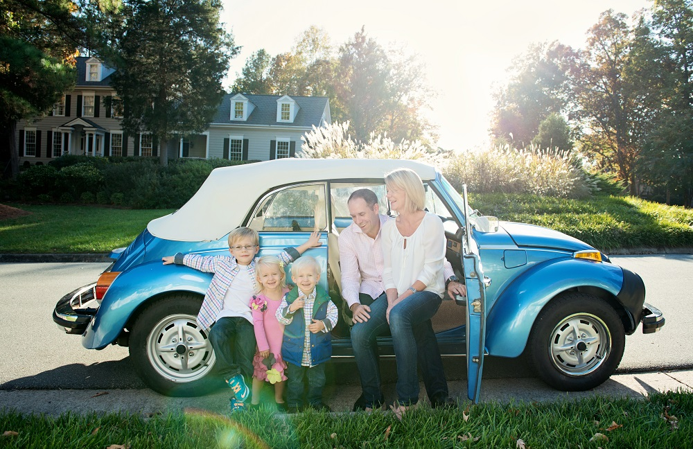 Tamara Lackey family photo with car outdoors