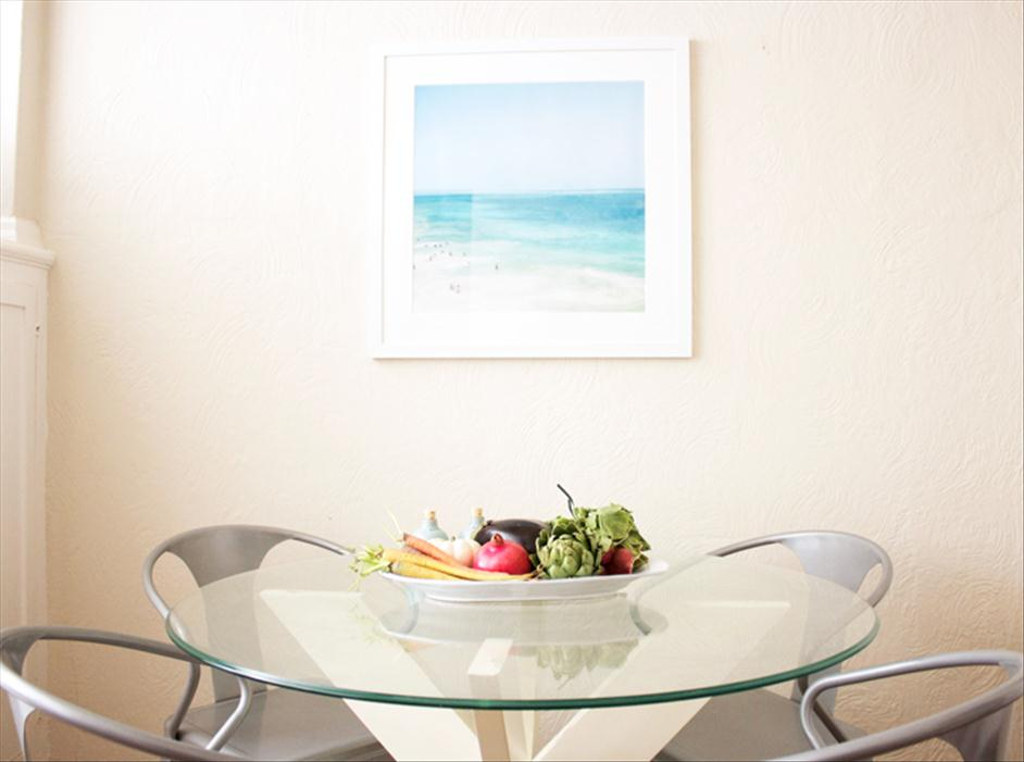 Framed photo of Tulum hung over table