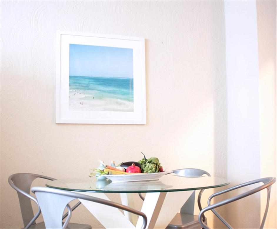 Framed photograph of Tulum hanging over table