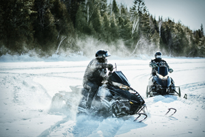 Snowmobiling on Long Lake, Maine