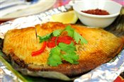 Ikan Bakar (Banana Leaf Grilled Stingray)   $16.99