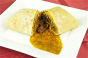 Curry Goat Roti   $9.30