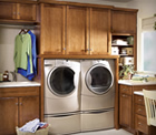 Merillat cabinets offer great storage in the laundry room