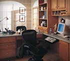 Merillat cabinets create desk space and storage in the home office