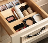 A drawer divider is one of Merillat's vanity storage solutions