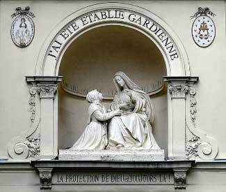 Statue of St. Catherine Labouré kneeling beside Our Lady