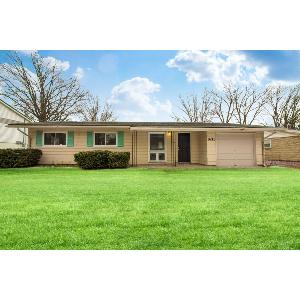 Charmer in Warren Twp with 1 1/2 baths and attached garage!