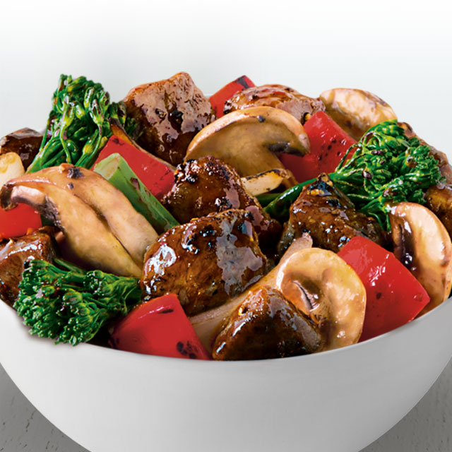 Angus steak wok-seared with baby broccoli, onions, red bell peppers and mushrooms in a savory black pepper sauce.