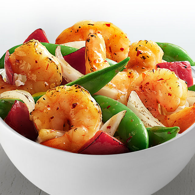 Seared premium shrimp with fresh veggies tossed in a sweet and spicy sauce and wok'd to perfection.