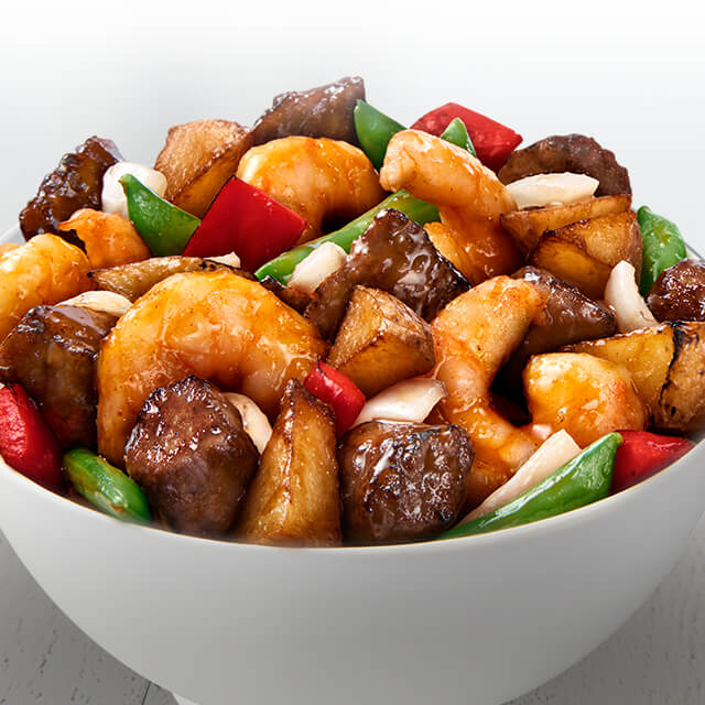Premium angus sirloin steak, plump, juicy shrimp, crisp snap peas, crisped potatoes, red bell peppers, and onions in a sweet and savory sauce.