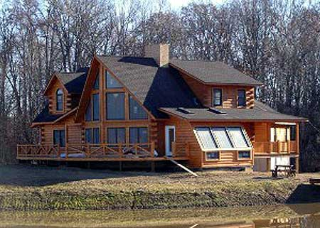 Massive custom log home with lots of windows