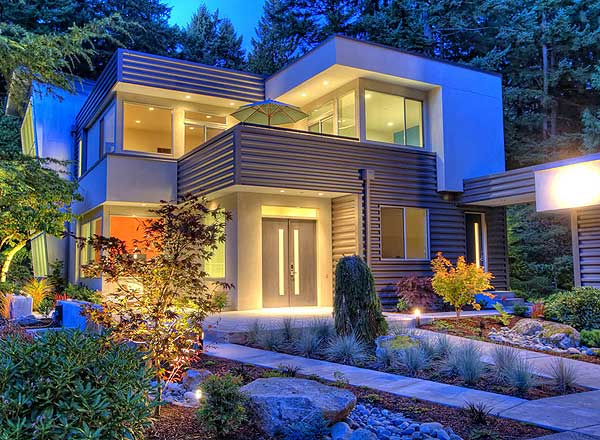 Night picture of the front entrance of 2-story modern contemporary home