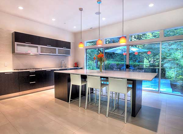 Picture of eat-in kitchen area with view of the heavily treed backyard