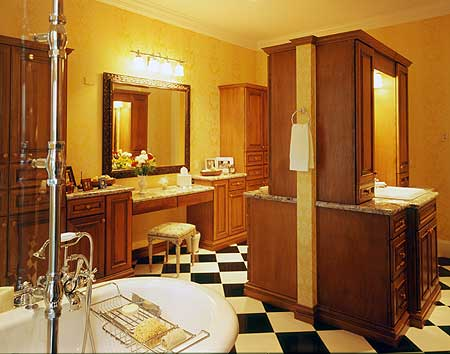 Master bath designed with extensive wood fixtures, black and white checkered floor and yellow walls
